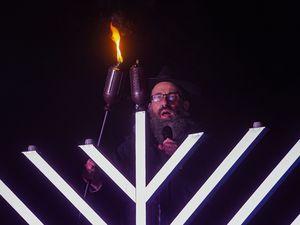 (Rick Egan   The Salt Lake Tribune) Rabbi Benny Zippel lights Utah's tallest menorah, 20 feet tall at the Utah State Capitol, for the first night of Hanukkah, on Thursday, Dec. 10, 2020.