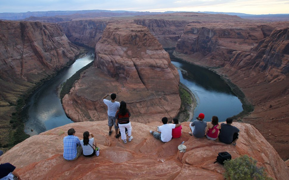This Sept. 9, 2011, photo shows the dramatic bend in the Colorado River at the popular Horseshoe Bend in Glen Canyon National Recreation Area, in Page, Ariz. The spot is so popular that authorities have imposed parking restrictions for safety, and a new viewing deck has also been built recently. (AP Photo/Ross D. Franklin)