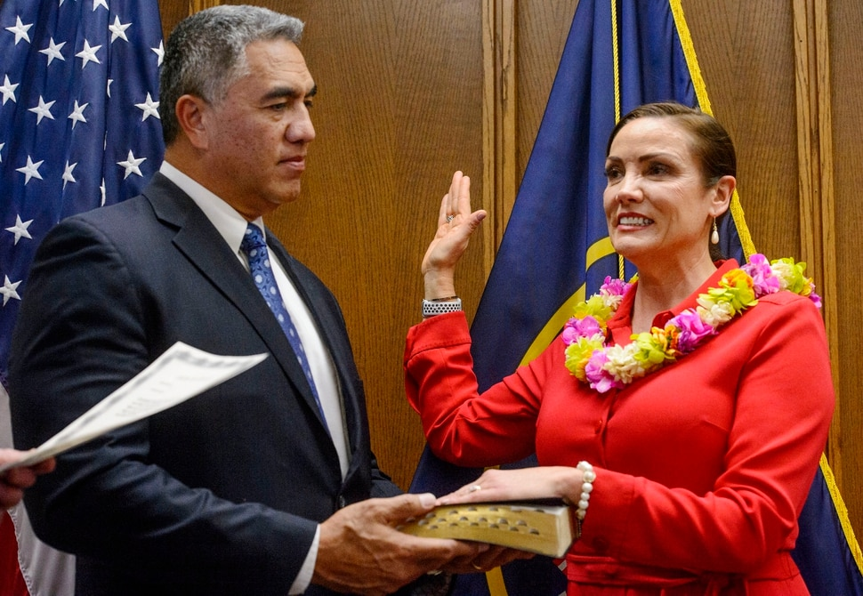 (Steve Griffin | The Salt Lake Tribune) As her husband Steve Kaufusi holds the Bible Michelle Kaufusi takes the Oath of Office as she becomes the first female mayor in Provo city's history. The small private ceremony was held in the Mayor's Office in Provo Tuesday January 2, 2018. A public Inauguration Ceremony for Mayor Kaufusi will be held at the Provo Library on January 18, 2018.