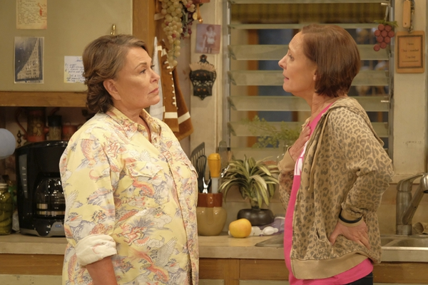 (Associated Press via Adam Rose/ABC) In this image released by ABC, Roseanne Barr, left, and Laurie Metcalf appear in a scene from the reboot of the popular comedy series