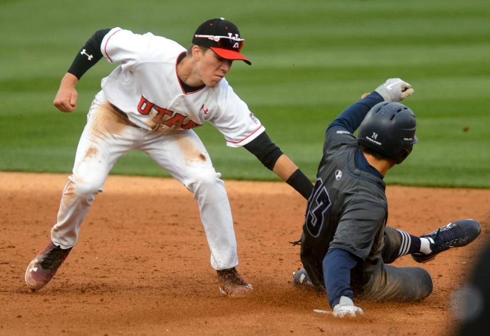 (Steve Griffin | The Salt Lake Tribune) Utah shortstop Matt Richardson tags out BYU baserunner Brian Hsu during the BYU versus Utah baseball game at Smiths Ballpark in Salt Lake City Tuesday April 3, 2018.