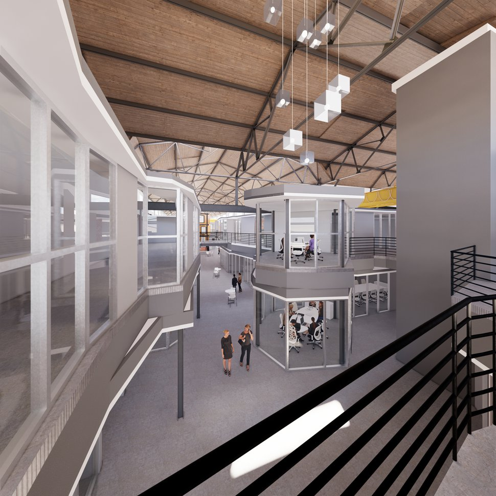 (Image courtesy of INDUSTRY) Rendering of new office spaces being built in Salt Lake City's Granary District by a company called Industry, founded by developers Ellen and Jason Winkler. They are overhauling the interior of a turn-of-the-century foundry at about 500 West and 700 South, in what the Winklers say is just a first phase in converting the surrounding industrial area into a neighborhood.