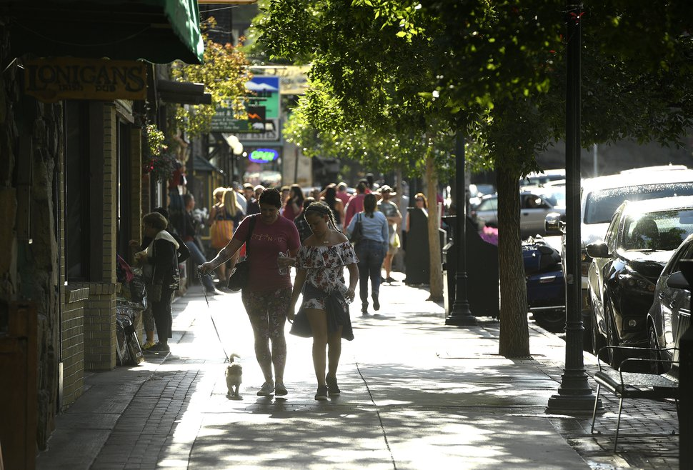 (Helen H. Richardson | The Denver Post) Tourists enjoy walking down West Elkhorn Ave on Aug. 5, 2018, in Estes Park, Colorado. The popular town is overrun with summer tourists who come to visit and explore nearby Rocky Mountain National Park.