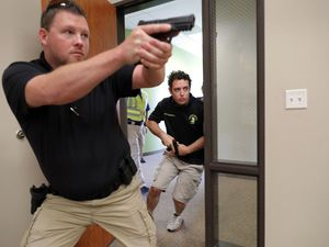 (Tony Gutierrez | AP Photo) In this July 21, 2019 photo, Trainees Chris Graves, left, and Bryan Hetherington, right, participate in a security training session at Fellowship of the Parks campus in Haslet, Texas. An industry has sprung up following mass shootings at houses of worship around the country to train civilians to protect their churches with the techniques and equipment of law enforcement.