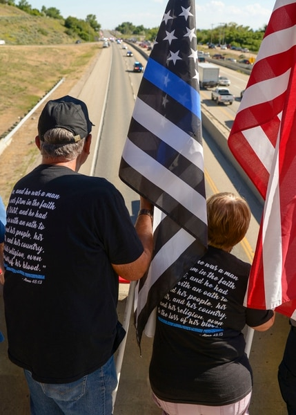 (Leah Hogsten | The Salt Lake Tribune) Ron and Marjorie Ellsworth, parents of UHP Trooper Eric Dale Ellsworth, who was struck by a vehicle and killed in 2016 were on the SR193 overpass to welcome fallen Ogden City Police Officer Nate Lyday back to Ogden. Lyday was transported from the Medical ExaminerÕs office in West Valley City to a mortuary in Ogden on Friday. Officer Lyday died in a shooting after responding to a domestic violence call May 28, 2020 in Ogden. A suspect was killed and an officer with Adult Probation and Parole was injured at the scene.