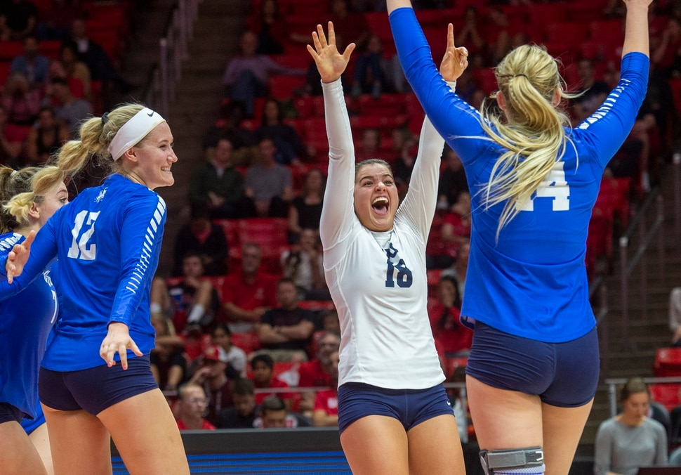 (Rick Egan | The Salt Lake Tribune) Kate Grimmer (12) , Mary Lake (18) and McKenna Miller (14) celebrate as BYU closes in on winning the 3rd set, over Utah, in volleyball action at the Jon M. Huntsman Center, Thursday, Sept. 19, 2019.