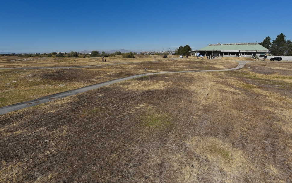 (Francisco Kjolseth   The Salt Lake Tribune) People gather at the Wingpointe Golf Course, adjacent to Salt Lake International Airport, on Tuesday, Oct. 16, 2018, for an announcement regarding plans to reopen the course. Congress recently passed the Federal Aviation Administration Act, which included Rep. Chris Stewart's language to allow Salt Lake City to reopen the golf course that closed in 2015.