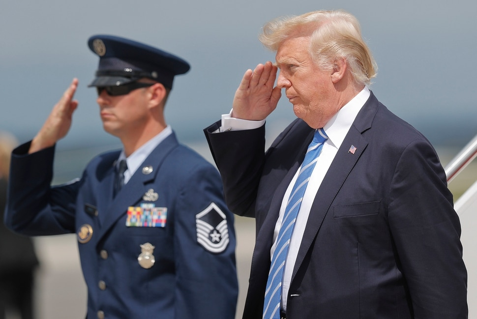 President Donald Trump returns a salute upon his arrival at Hagerstown Regional Airport in Hagerstown, Md., on Air Force One, Friday, Aug. 18, 2017, en route to nearby Camp David, for a meeting with his national security team to discuss strategy for South Asia, including India, Pakistan and the way forward in Afghanistan. (AP Photo/Pablo Martinez Monsivais)