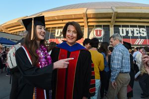 (Francisco Kjolseth     The Salt Lake Tribune)  University of Utah President Ruth Watkins meets with students, including nursing graduate Caitlin Keenan, after commencement ceremonies on Thursday, May 3, 2018, at the Jon M. Huntsman Center. She announced Jan. 12, 2021, that she is stepping down from leading the school.
