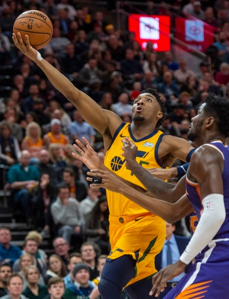 (Rick Egan | The Salt Lake Tribune) Utah Jazz guard Donovan Mitchell (45) takes the ball to the hoop, in NBA action between the Utah Jazz and Phoenix Suns, in Salt Lake City, Friday, Feb 6, 2018.