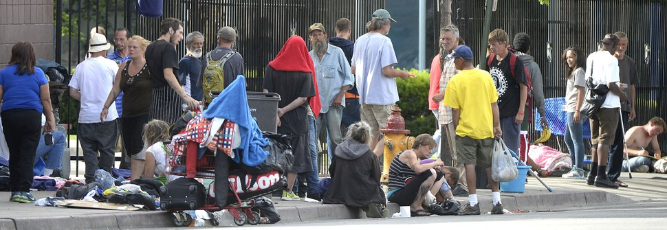 Al Hartmann | The Salt Lake Tribune Homeless gather with their belongings to wait out the day's heat near 500 West and 250 South in downtown Salt Lake City Friday June 10. While the mayor's commission on homelessness plods forward with long-term solutions, residents and business owners downtown say things are not improving regarding issues, such as drug use, and crime in the Rio Grande neighborhood.