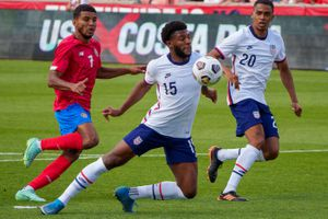 (Trent Nelson     The Salt Lake Tribune) United States defender Mark McKenzie blocks the ball away from the goal as the U.S. Men's National Team (USMNT) faces Costa Rica in a friendly at Rio Tinto Stadium in Sandy on Wednesday, June 9, 2021. At rear are Costa Rica forward Johan Venegas and United States defender Reggie Cannon.