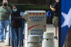 (Rick Egan  |  The Salt Lake Tribune)    Voters drop their ballots in the vote-by-mail ballot drop box at the Salt Lake County Government Center on Monday, Oct. 19, 2020.