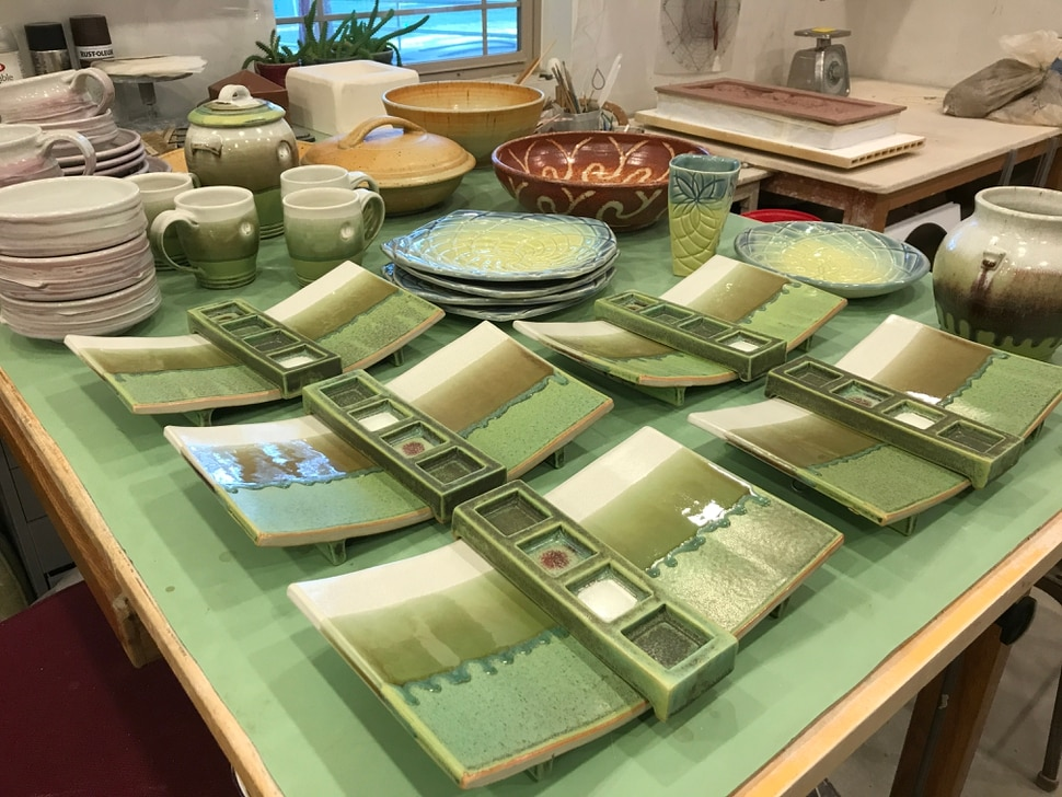(Julie Hirschi | Special to The Tribune ) Glazed ceramic sushi trays and pottery for sale by Suzanne Conine in her home studio in Draper. Her work will be showcased alongside other artists during the Wasatch Studio Tour, Oct. 12 and 13, 2019.