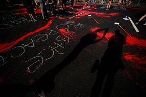 (Trent Nelson     Tribune file photo) Protesters paint the street red in front of the Salt Lake County District Attorney's office in Salt Lake City on Thursday, July 9, 2020.