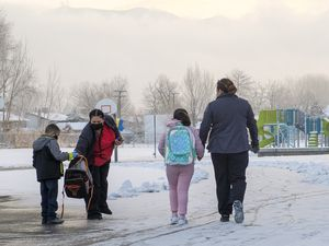 (Leah Hogsten | The Salt Lake Tribune) Parents walk their Escalante Elementary students back to class in Salt Lake City head back to class, January, 25, 2021. Salt Lake City School District reopened all of the district's elementary schools to in-person learning on Monday. It is the first time students in kindergarten through sixth grade are back in the classroom for a full day of school since they first closed for the pandemic in March 2020.