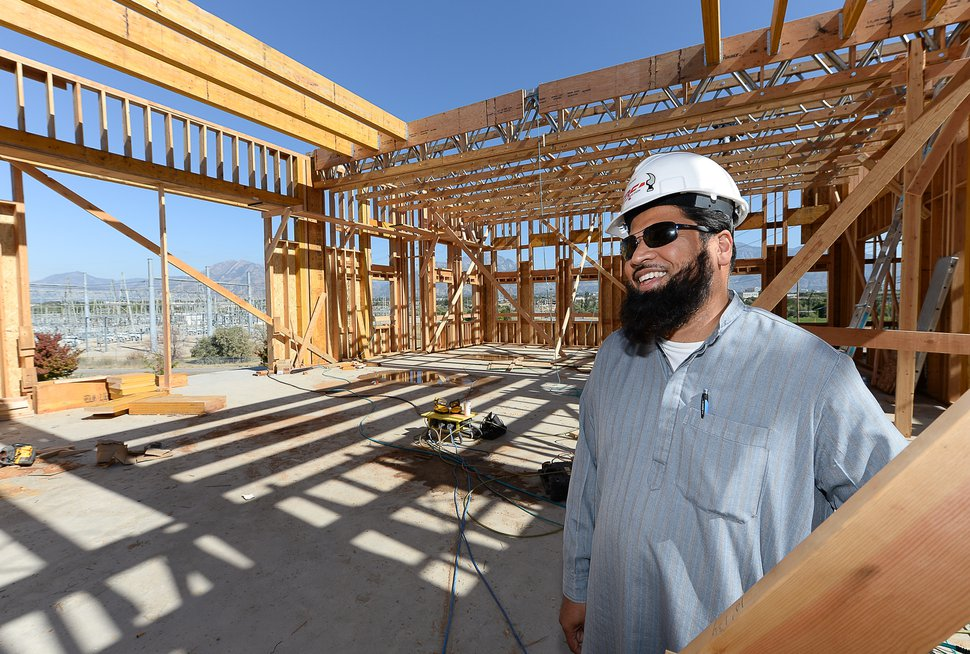 (Francisco Kjolseth | Tribune file photo) Imam Shuaib Din tours the site of the new mosque going up in West Jordan in October 2019.