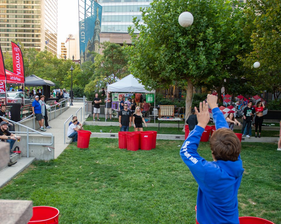 (Rachel Molenda | The Salt Lake Tribune) Concertgoers play a giant game of beer pong at the Twilight Concert Series in downtown Salt Lake City on Thursday, Sept. 6, 2018.