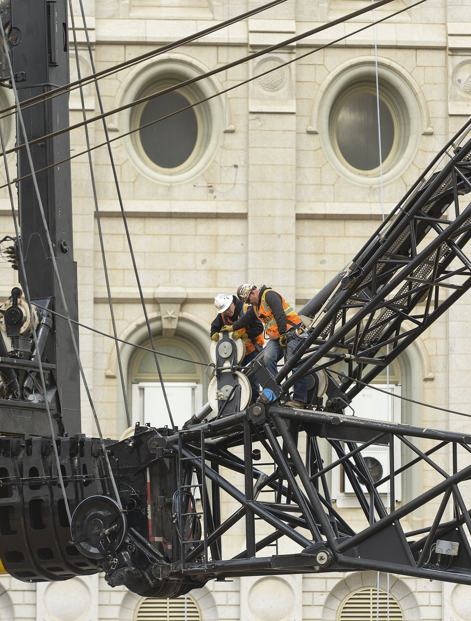 (Leah Hogsten | The Salt Lake Tribune) Crews rig a giant crane on the grounds of The Church of Jesus Christ of Latter-day Saints' Salt Lake Temple, April 2, 2020. The temple, closed in December for seismic upgrades, sustained minor damage during the March 18, 2020, earthquake. The trumpet on the Angel Moroni statue fell off, and there is minor displacement of some of the temple's smaller spire stones.