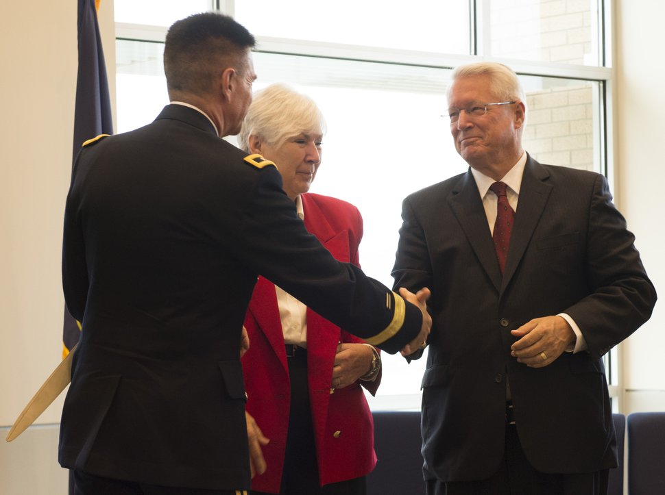 Rick Egan | The Salt Lake Tribune Adjutant General. Maj. Gen. Jefferson Burton (left) stands next to Gail Miller (center) as he shakes hands with Bishop Dean Davies, LDS Church (right), at the ribbon-cutting ceremony for Sunrise Hall, a newly constructed worship center at Camp Williams. Friday, August 7, 2015.