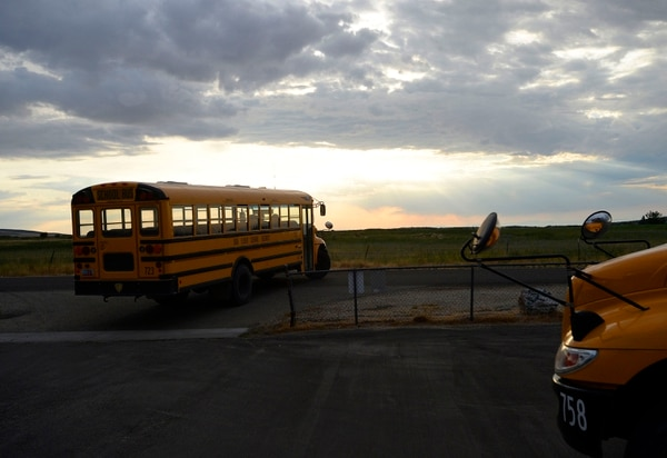 (Al Hartmann | The Salt Lake Tribune) Two school buses ferry students to and from Park Valley School, for first bell at 7:40 a.m. on Wednesday, Aug 30, 2017. Having a new four-day school week made for long days that first week of school.