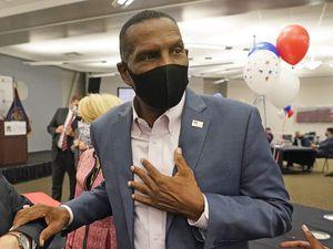 (Rick Bowmer | AP file photo) Burgess Owens speaks with people during an Utah Republican election night party, Nov. 3, 2020, in Sandy, Utah.