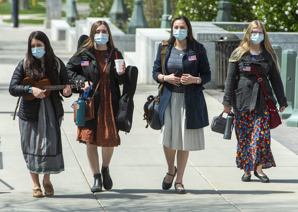 (Rick Egan | Tribune file photo) Missionaries from The Church of Jesus Christ of Latter-day Saints wear face masks as they walk down West Temple, April 9, 2020