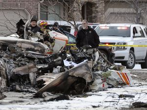 (Leah Hogsten     The Salt Lake Tribune) Weber County emergency personnel and firefighters work the scene of a small, private plane that crashed in a residential neighborhood in Roy, Jan 15, 2020.  A 64-year-old pilot was killed.
