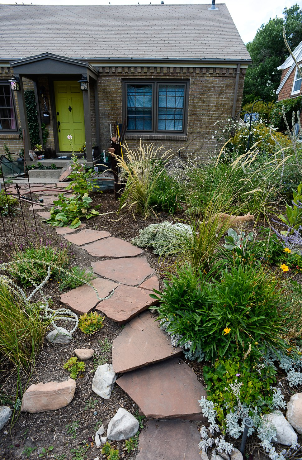 (Francisco Kjolseth | Tribune file photo) A xeriscaped yard in Salt Lake City, featuring rocks and drought-resistant plants to reduce water usage.
