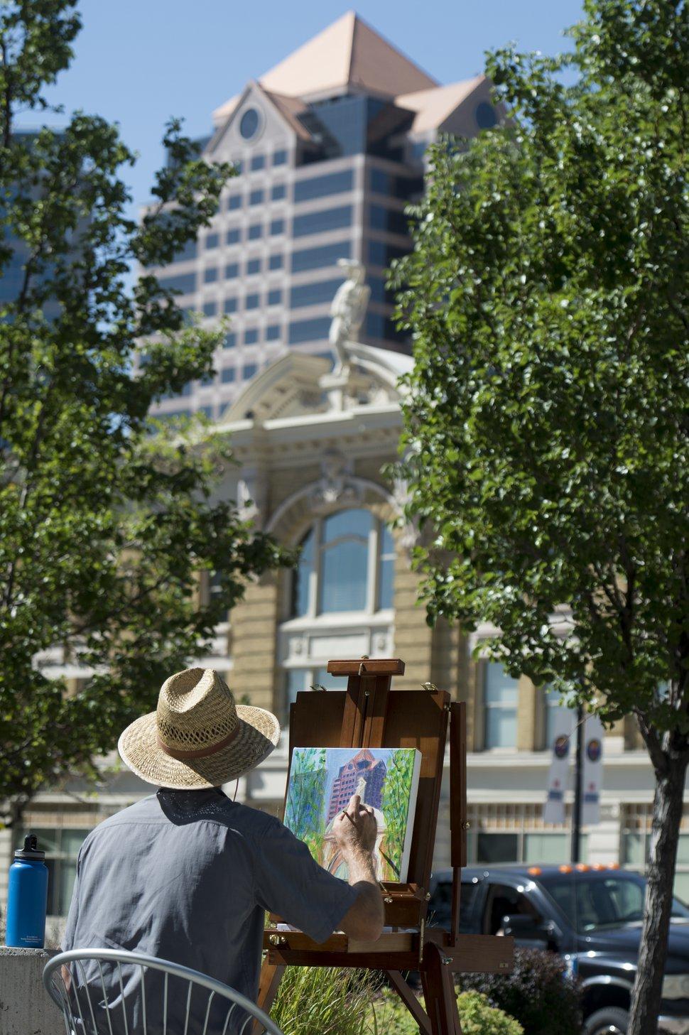(Rick Egan | The Salt Lake Tribune) Albert Wint paints in front of the Federal Building as part of The Blocks Urban Plein Air Festival.