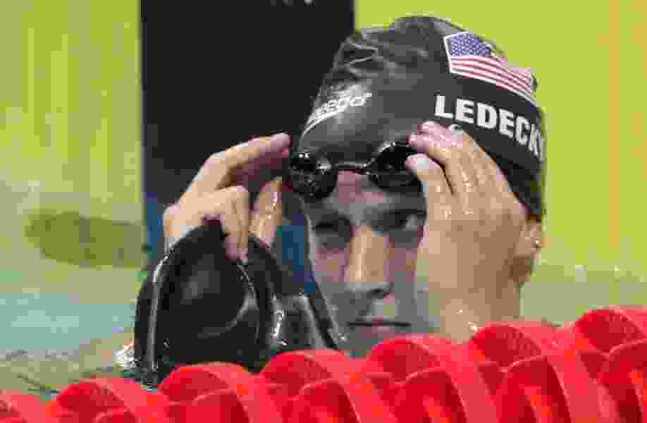 Katie Ledecky shatters own world record in first pro event