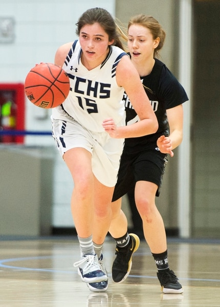 (Rick Egan | The Salt Lake Tribune) Corner Canyon Chargers Kemery Martin (15) brings the ball down court on a Charger fast break, in Class 5A women's basketball playoff game between Corner Canyon and Highland, Monday, Feb. 19, 2018.
