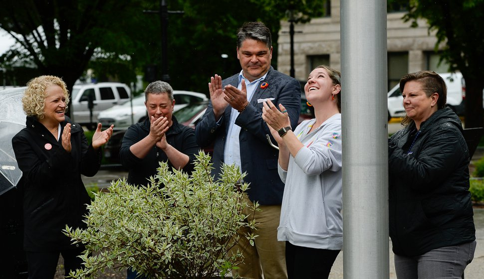(Francisco Kjolseth | Tribune file photo) In happier times for the Utah Pride Center, Executive Director Rob Moolman, center, cheers the raising of the pride flag over Salt Lake City Hall, May 28, 2019. Then-Salt Lake City Mayor Jackie Biskupskie, left, applauds with Liz Pitts. To Moolman's right are bek Birkett and Hillary McDaniel. Pitts, Birkett and McDaniel all have been laid off from the center in recent weeks.