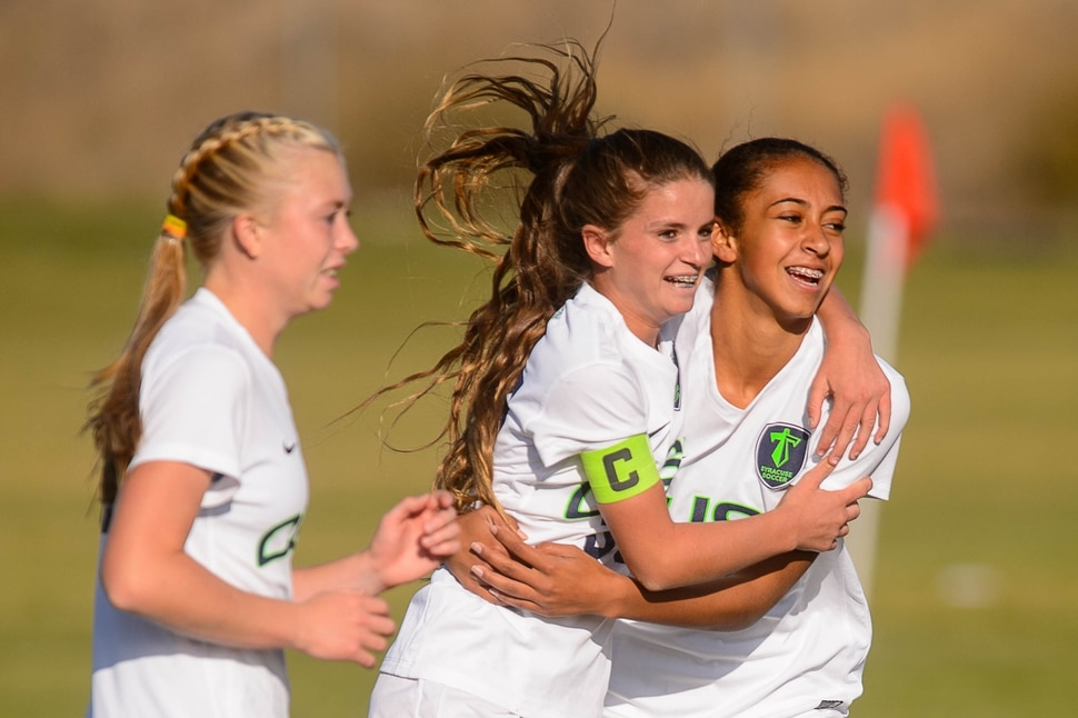 (Trent Nelson | The Salt Lake Tribune) Syracuse's Caroline Stringfellow (35, center) celebrates a goal with teammate Lexi Chenoweth in the Class 6A girls' soccer state quarterfinal between Pleasant Grove and Syracuse, in Syracuse Thursday October 12, 2017. Ashlyn Hall at left.