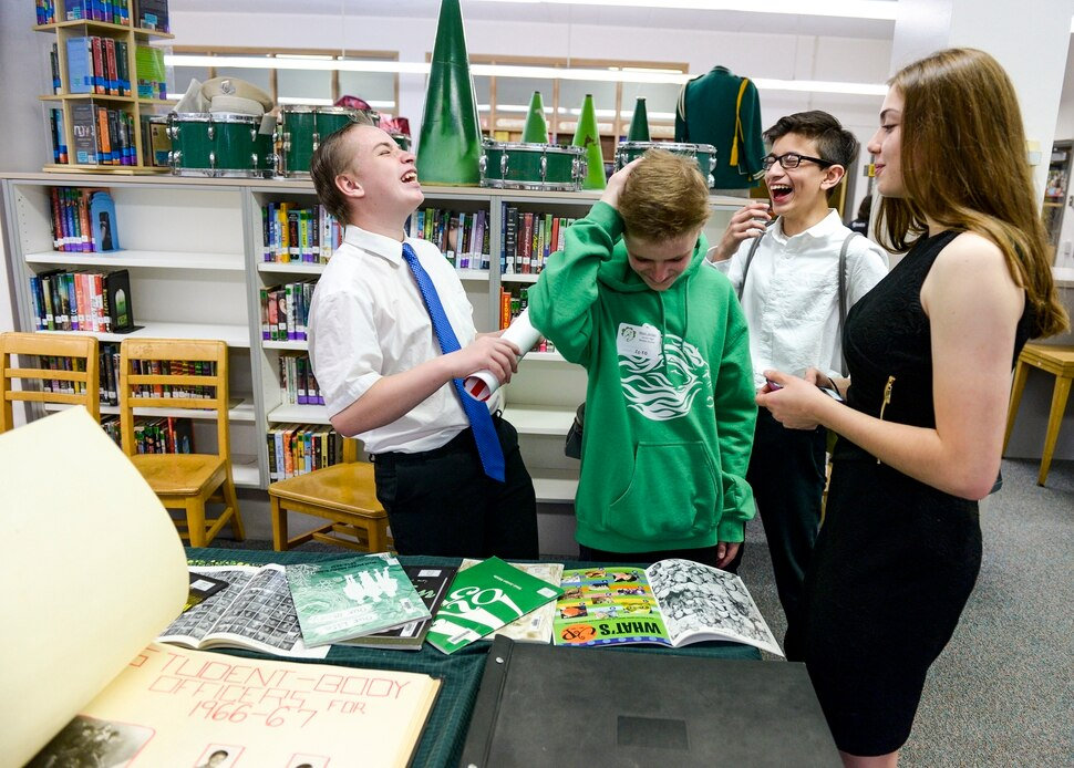 (Leah Hogsten | The Salt Lake Tribune) l-r Current West Jordan Middle School 8th graders Hiram Bertoch, Josh Ballard, Mariano Garnica and Avery Schaefer laugh while looking at yearbooks in the schoolÕs media center. Former students, teachers, staff and members of the community gathered on Saturday to bid a fond farewell to the 60-year-old West Jordan Middle that will be torn down at the end of this school year. The school opened in 1958.