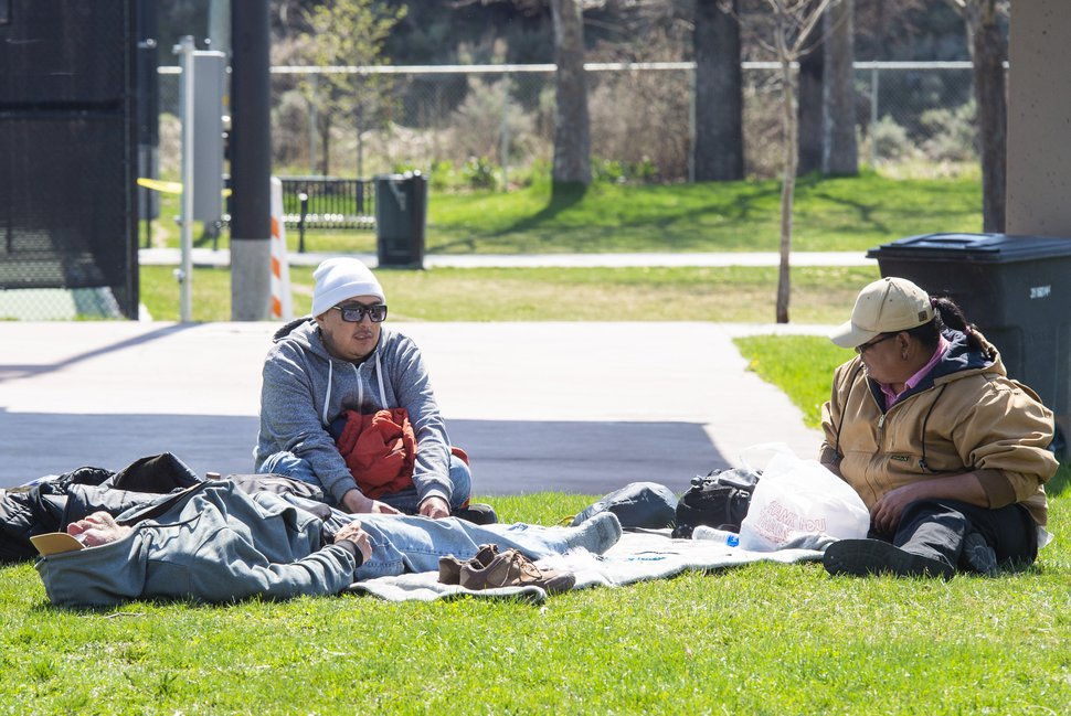 (Rick Egan | The Salt Lake Tribune) Three men experiencing homelessness who are staying in the Sugar House temporary shelter, pass the time at Fairmont Park, Wednesday April 1, 2020