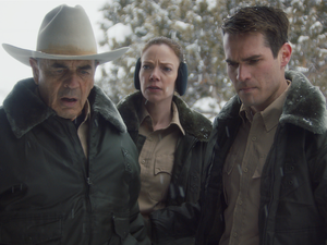 "(Photo courtesy of Orion Classics) Sheriff Hadley (Robert Forster, left), along with deputies Julia Robson (Riki Lindhome, center) and John Marshall (Jim Cummings) look at a bloody murder scene, in the filmed-in-Utah horror thriller ""The Wolf of Snow Hollow."""