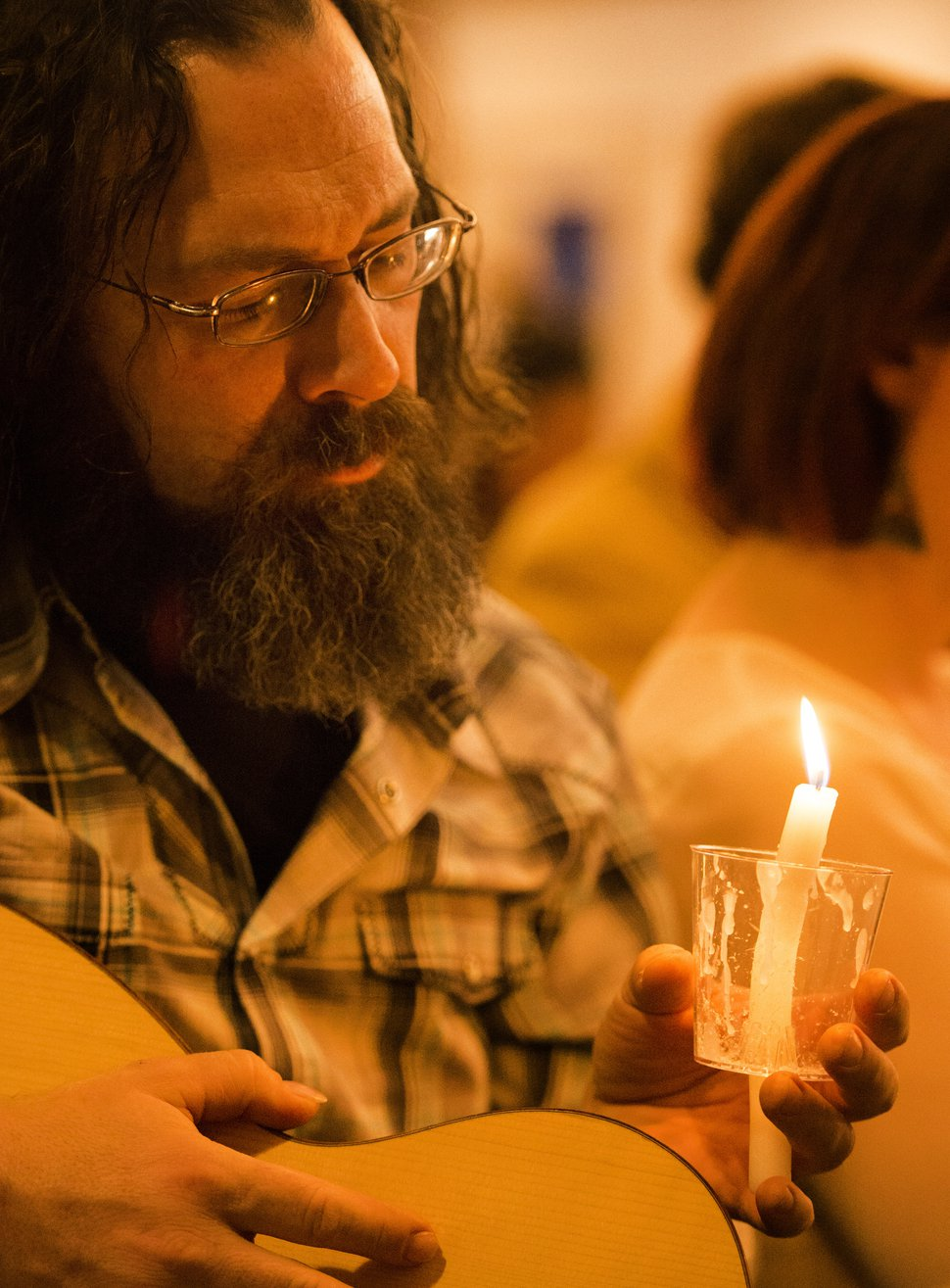 Rick Egan | The Salt Lake Tribune Peter Danzig holds a candle during a vigil to mark the 10th anniversary of theTrolley Square shootings at Zion Evangelical Lutheran Church, Sunday, February 12, 2017.