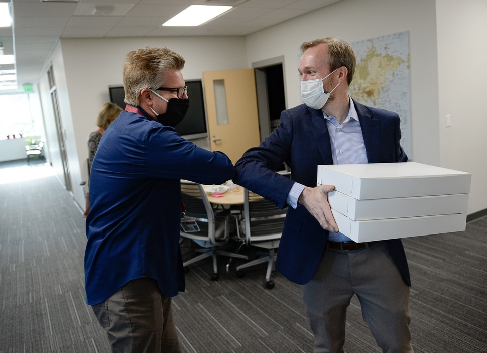 (Francisco Kjolseth | The Salt Lake Tribune) Congressman Ben McAdams, D- Utah, right, brings donuts as he bumps elbows with public health nurse Jeffrey Sanchez after meeting him in person for the first time at the Salt Lake County Public Health Center on Tuesday, April 28, 2020. Sanchez was the one who conducted his contact tracing over the phone when the congressman became infected with COVID-19. As of last week, the county had reached at least 10,000 people who have had contact with one of the 1,900 confirmed coronavirus cases.