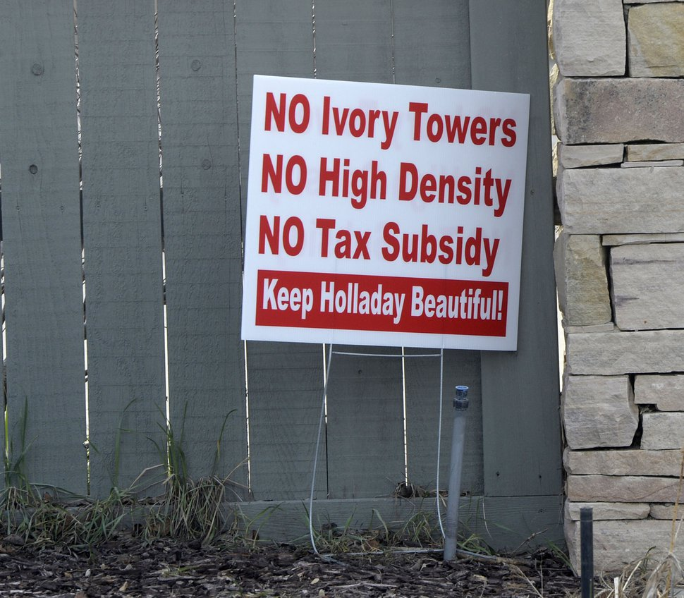 (Al Hartmann | Tribune file photo) Signs in the front yards of homeowners in the area of the old Cottonwood Mall site near 4800 S. Highland Drive in Holladay, as seen in March.