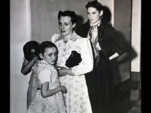 (Tribune file photo) Vera Johnson Black comforts Elsie, 11, as Emily, 9, holds her sister's arm. At the rear is Lillian, 14. Seven of Black's children were placed in state custody after the 1953 raid on Short Creek, which led to a Utah Supreme Court case. Black died this week at age 102.