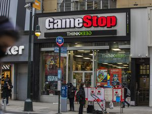 (Hiroko Masuike | The New York Times) A GameStop store in Manhattan on Wednesday, Jan. 27, 2021. GameStop shares have soared 1,500 percent as millions of small investors, egged on by social media, employ a classic Wall Street tactic to put the squeeze — on Wall Street.