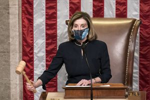 (J. Scott Applewhite | The Associated Press) House Speaker Nancy Pelosi, D-Calif., leads the final vote of the impeachment of President Donald Trump for his role in inciting an angry mob to storm the Congress last week, at the Capitol in Washington, Wednesday, Jan. 13, 2021.