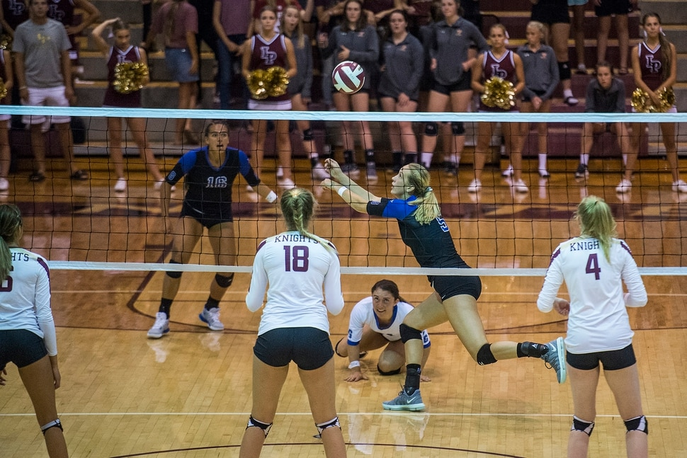 (Chris Detrick | The Salt Lake Tribune) Pleasant Grove's Heather Gneiting (5) goes for the ball during the volleyball match at Lone Peak High School Tuesday, September 5, 2017.