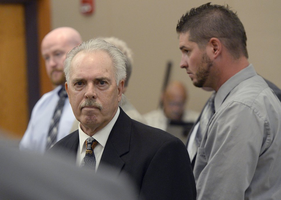 (Al Hartmann | Tribune file photo) Former Daggett County Sheriff Jerry Jorgensen, front left, huddles with lawyers and former jail commander Lt. Benjamin Lail, right, in 3rd District Court in Park City on July 17, 2017, before Judge Kent Holmberg on charges connected to the abuse of jail inmates at the Daggett County jail. A third person charged at far left is Deputy Joshua Cox.