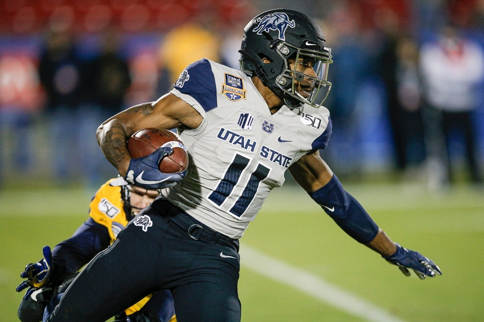 Utah State's Savon Scarver (11) carries the ball on a kick return during the first half of the Frisco Bowl NCAA college football game against Kent State on Friday, Dec. 20, 2019, in Frisco, Texas. (AP Photo/Brandon Wade)