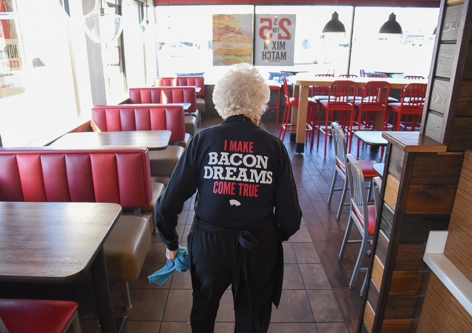 (Francisco Kjolseth | The Salt Lake Tribune) Making the rounds to clean up table tops, after 25 years at Arby's, 94-year-old Dorothy Bale has no plans to retire from the job she started when she was 69.