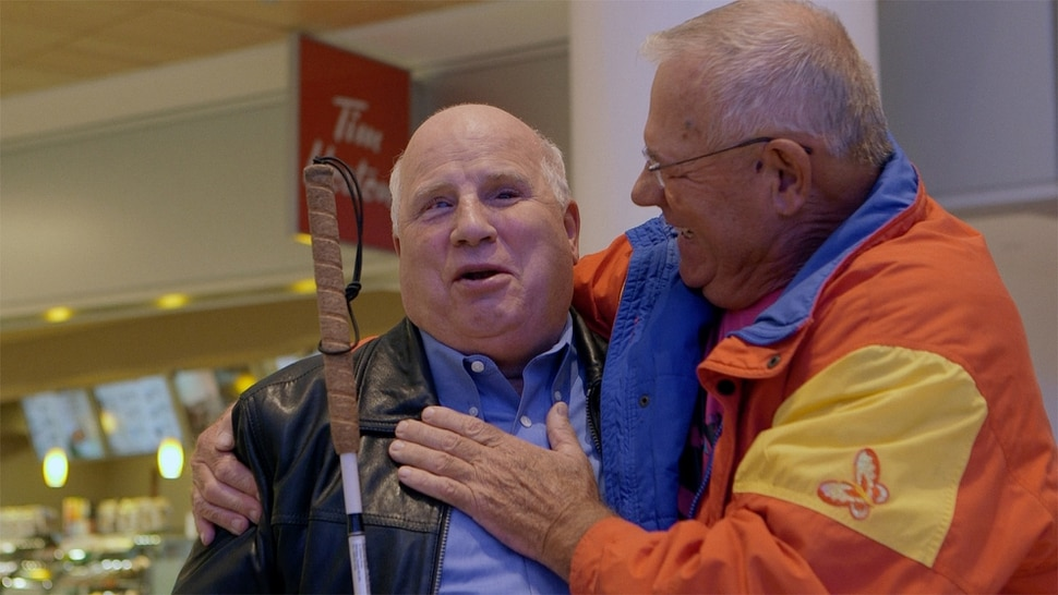 (Courtesy Music Box Films) Shep Shell, a blind man living in Winnpeg, is reunited with his long lost brother, Israeli Izak Szewelewicz, in a scene from the documentary