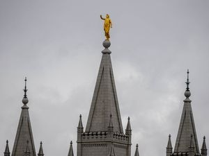 (Trent Nelson     The Salt Lake Tribune) The statue of Moroni, missing its horn, atop the Salt Lake Temple, damaged in an earthquake in Salt Lake City on Wednesday, March 18, 2020.