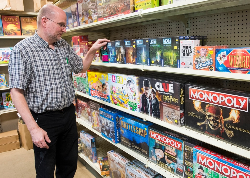 (Rick Egan | The Salt Lake Tribune) Owner Paul Hammond arranges games on the shelf of Hammond Toys. Hammond Toys has been in business since 1954. Thursday, March 22, 2018.
